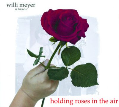 Willi_Meyer_holding_roses_in_the-air_(1)